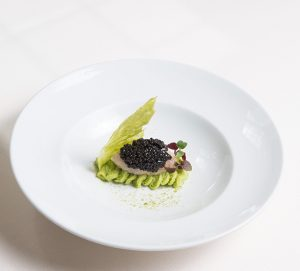 Pea puree, chopped scampi flavored with lemon, caviar and franciacorta